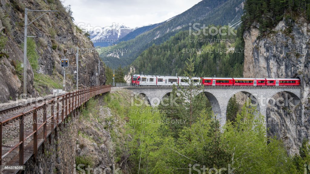 Glacier train on landwasser Viaduct bridge, Switzerland stock photo