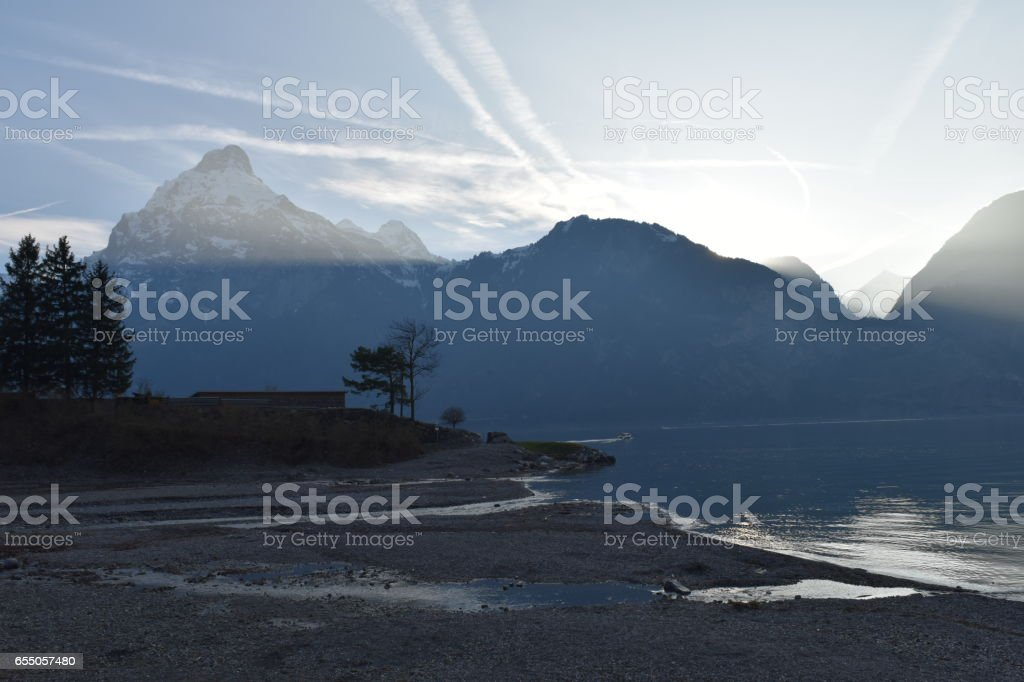 Glacier water running into lake stock photo