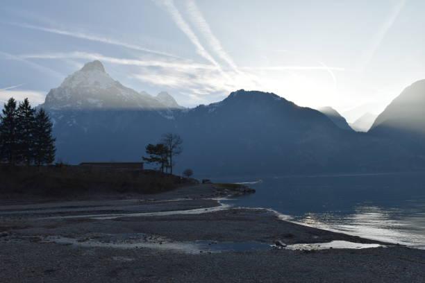 Glacier water running into lake stock photo