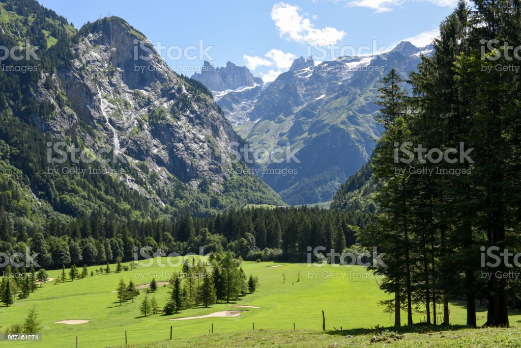 Glaciers and golf course at Engelberg on Switzerland stock photo