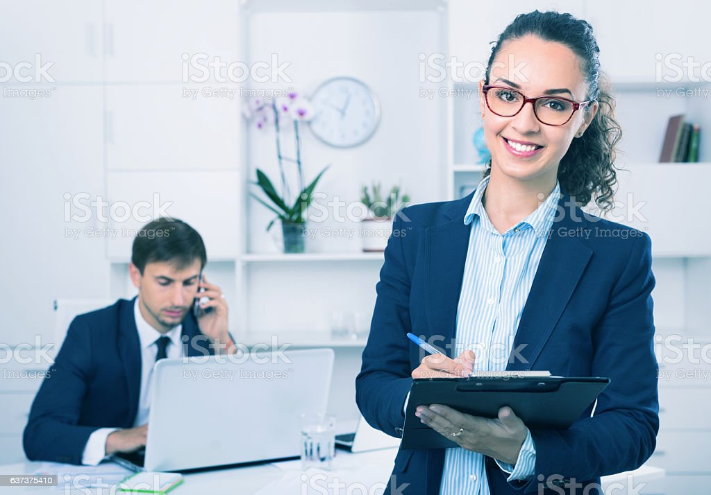 Glad business female secretary having cardboard in hands stock photo
