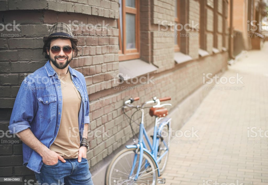 Glad guy having break during cycling - Royalty-free Adult Stock Photo