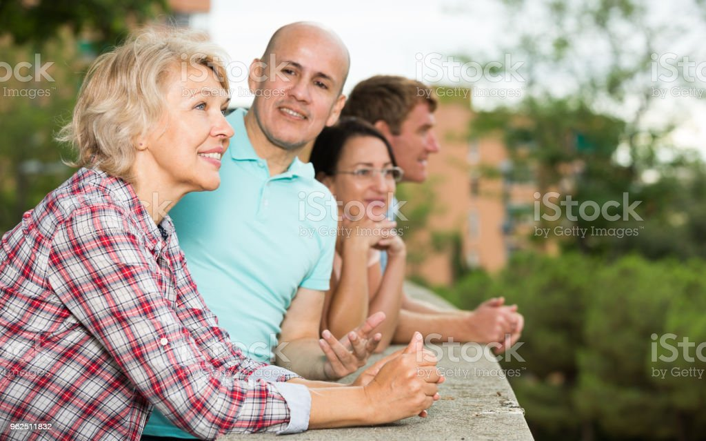 glad pensioners talking in the park - Royalty-free Adult Stock Photo