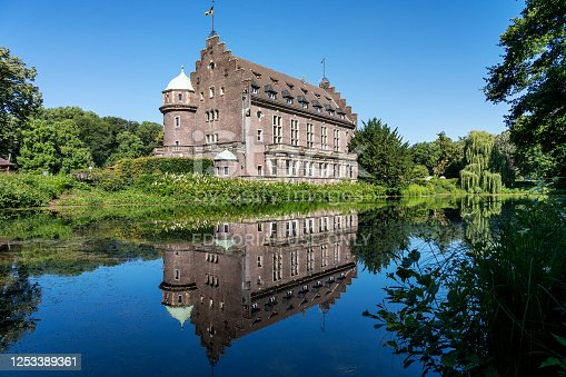 istock Gladbeck - View to Rearside of Manor-House at Castle Wittringen reflected in the Lake, North Rhine Westphalia, Germany, 25.06.2020 1253389361