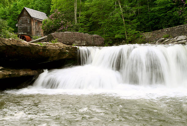Glade Creek Grist Mill in Babcock State Park, West Virginia The Glade Creek Grist Mill in Babcock State Park offers a picture perfect waterfall with the historic gristmill in the background. babcock state park stock pictures, royalty-free photos & images