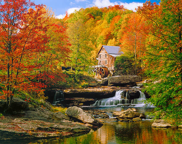 Glade Creek Grist Mill nostalgia blazing autumn colors West Virginia Picturesqe old Glade Creek Grist Mill with waterwheel and stream, in a blazing autumn colors setting.  Babcock State Park. babcock state park stock pictures, royalty-free photos & images