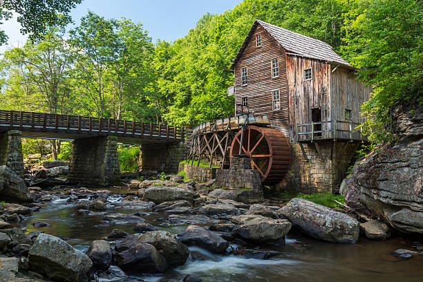 Glade Creek Grist Mill A grist mill by a creek in the woods. babcock state park stock pictures, royalty-free photos & images