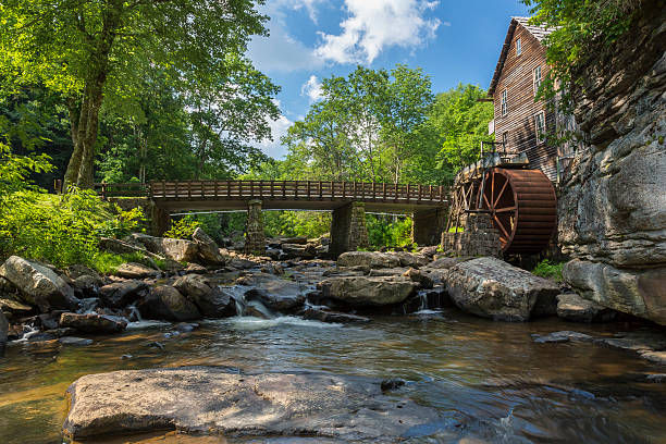 Glade Creek Grist Mill A grist mill next to a creek. babcock state park stock pictures, royalty-free photos & images