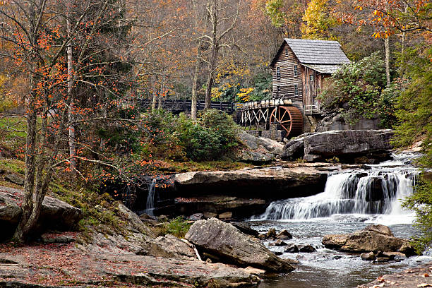 Glade Creek Gristmill in Fall season Beautiful old Glade Creek Mill at Babcock State Park in the autumn season also showing the waterfall and mill pond below the mill babcock state park stock pictures, royalty-free photos & images