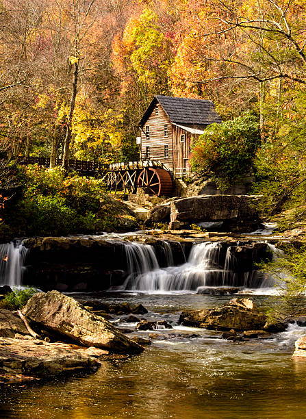 Glade Creek Gristmill in Peak Autumn Color Glade Creek Gristmill in Peak Autumn Color, silky waterfalls babcock state park stock pictures, royalty-free photos & images