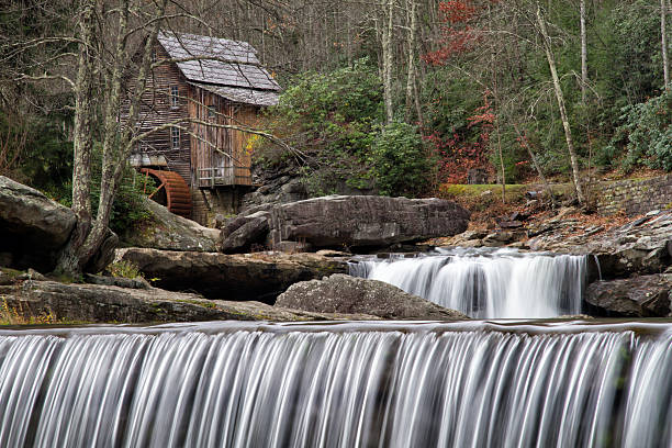 Gladecreek Gristmill with Waterfall in Foreground Glade creek Gristmill in late autumn with waterfalls in the foreground and middle babcock state park stock pictures, royalty-free photos & images