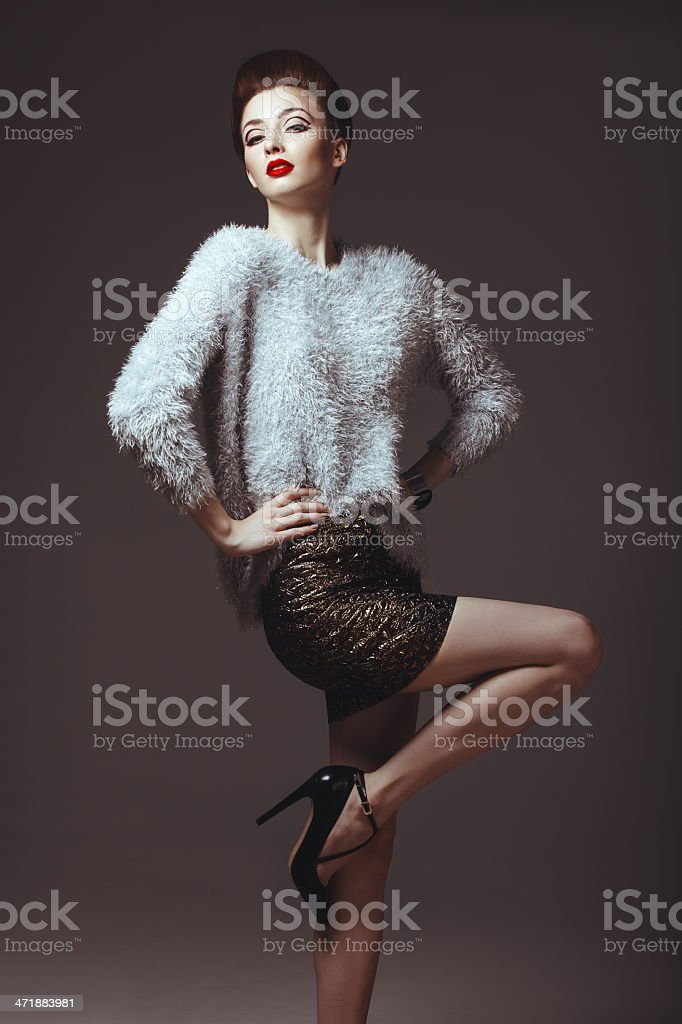 Glam diva in sweater stock photo