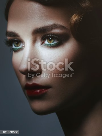 Studio portrait of beautiful glamourous  woman. 20's - 30's styled image. Professional make-up and hairstyle. High-end retouch.