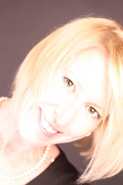Glamorous Beautiful Blond Woman Smiling stock photo