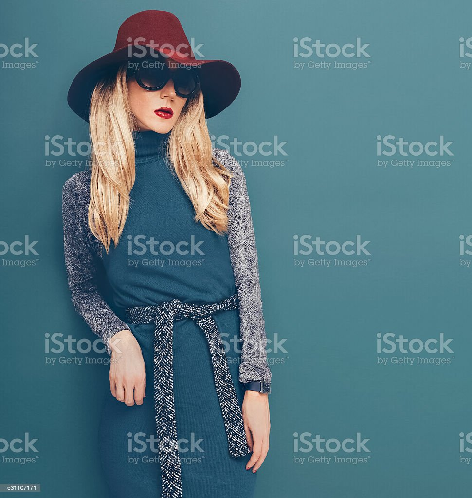 Glamorous blond model in vintage hat and dress stock photo