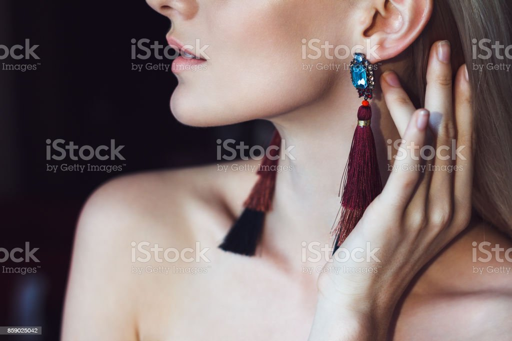 Glamorous blonde woman with beautiful earrings stock photo
