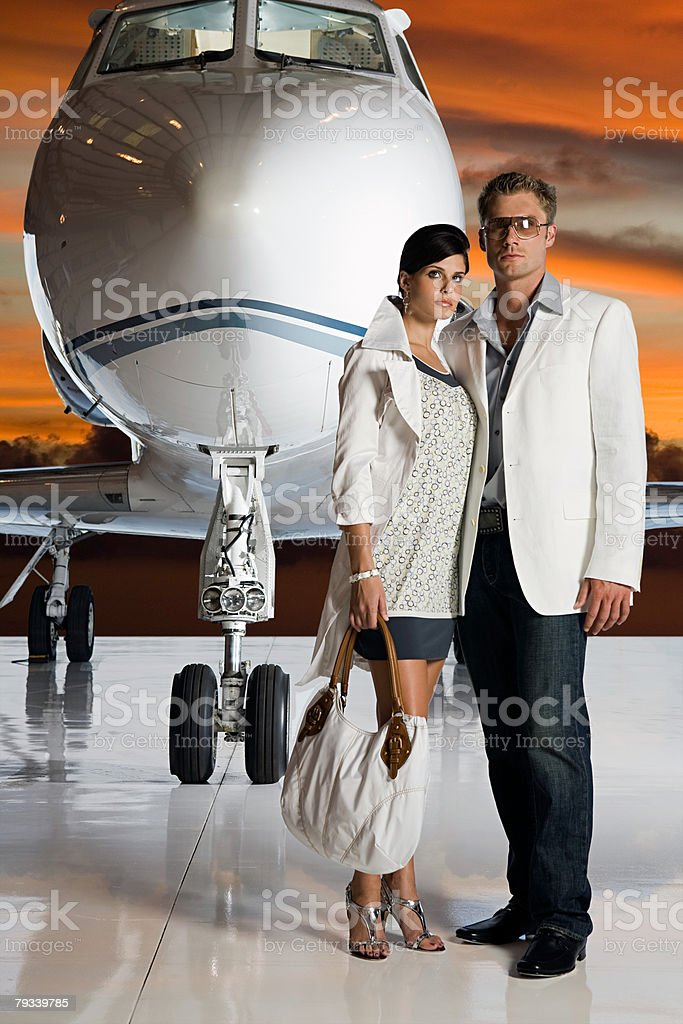 Glamorous couple by private airplane 免版稅 stock photo