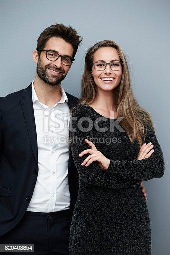 620404536istockphoto Glamorous couple smiling for camera 620403854