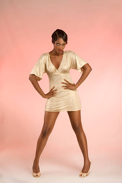 glamorous ethnic woman in sexy flirting pose - mini dress stock photos and pictures