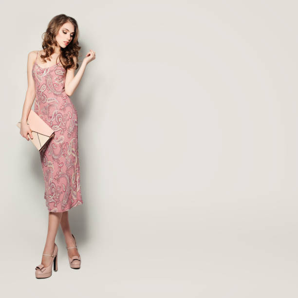 Glamorous Fashion Model Woman Standing on Background stock photo