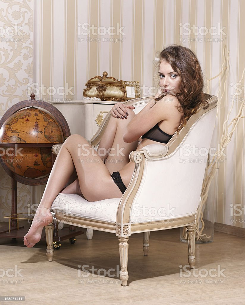 glamorous girl in home interior stock photo