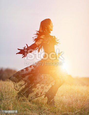 Glamorous goth woman and woodland with fall colors