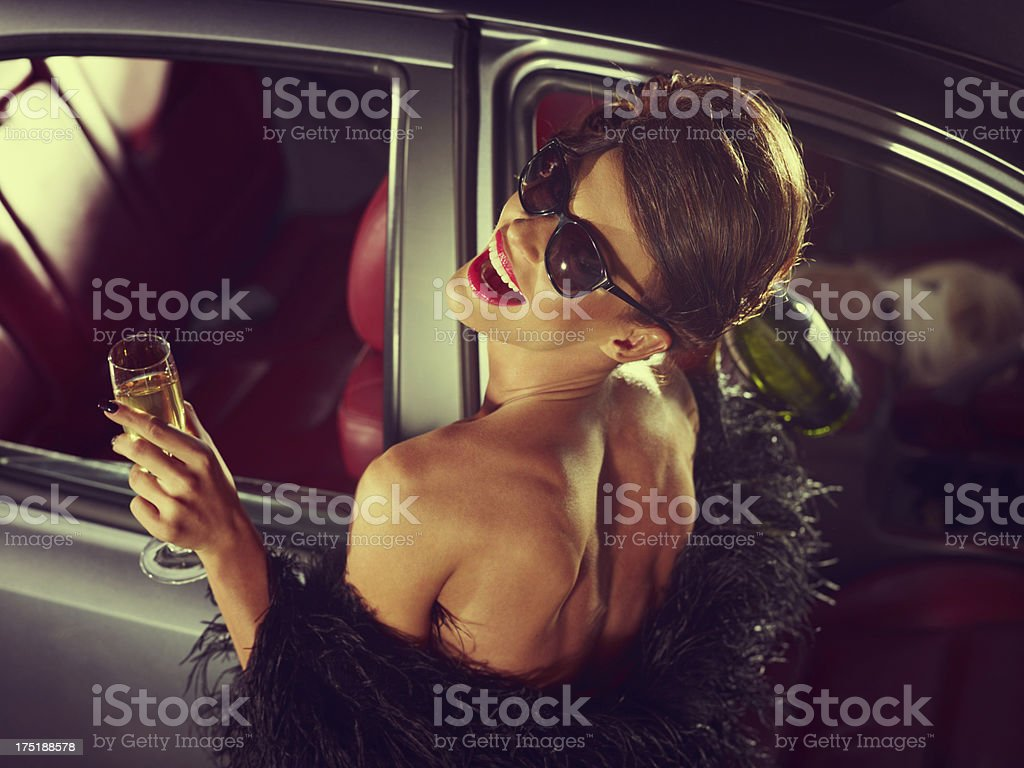 Glamorous Woman Celebrating New Year With Champagne stock photo