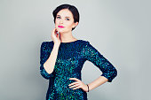 Glamorous Woman in Glitter Fashionable Dress Posing