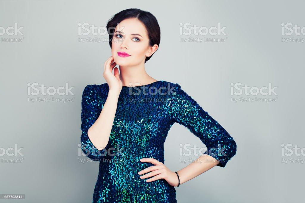 Glamorous Woman in Glitter Fashionable Dress stock photo