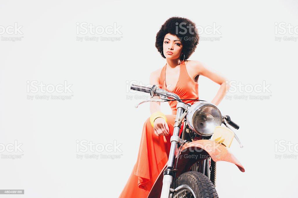 Glamorous woman on a motorbike stock photo