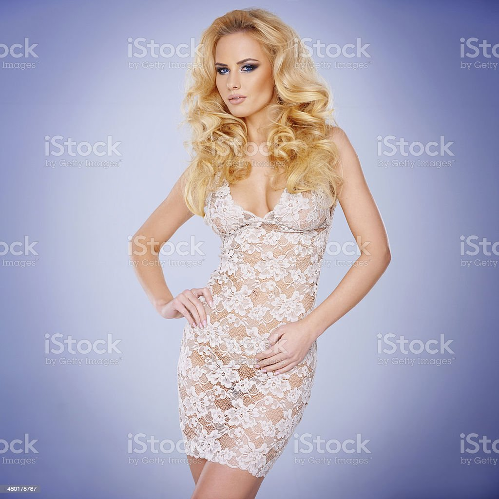 Glamorous young blond in a see-through dress royalty-free stock photo