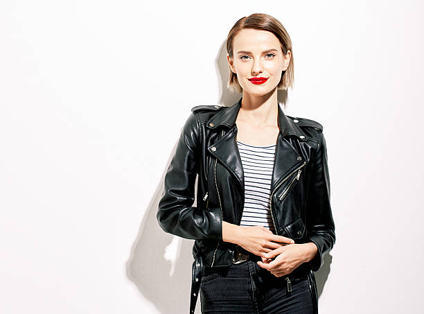 glamorous young woman in black leather jacket on white background - body parts of sexy girls stock pictures, royalty-free photos & images
