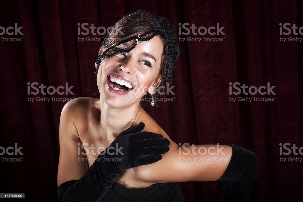 Glamorous Young Woman in Netted Hat and Black Gloves stock photo