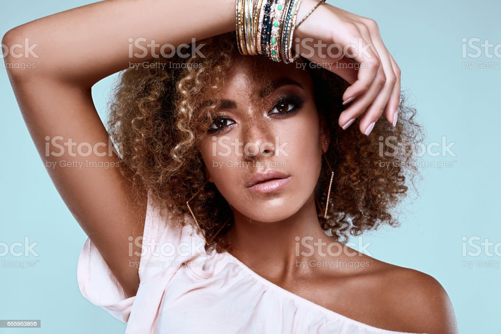 Glamour elegant black hippy woman model with curly hair stock photo