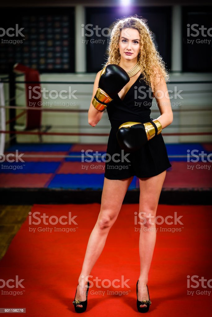 1a470526 Glamour fashion model woman with boxing gloves in sports gym. Strong,  active, independent female in high heels on the red carpet is wearing  golden kick ...