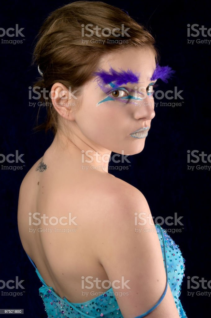 Glamour girl looks at camera over shoulder. royalty-free stock photo