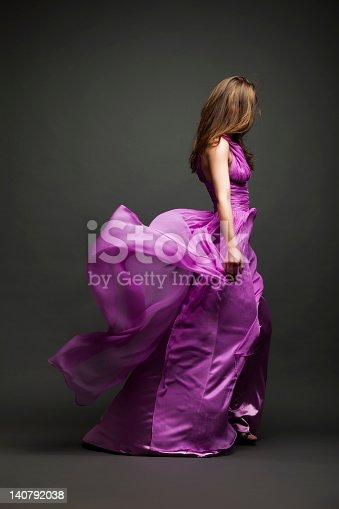 Elegant glamour girl in blue dress, studio shot