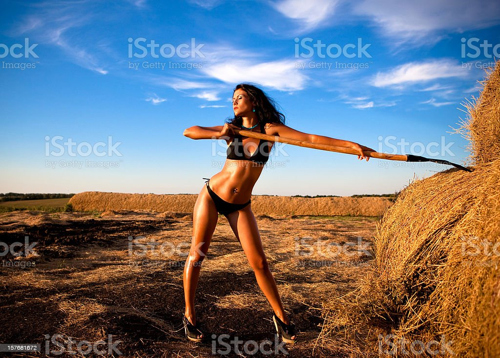 Glamour girl with pitchfork royalty-free stock photo