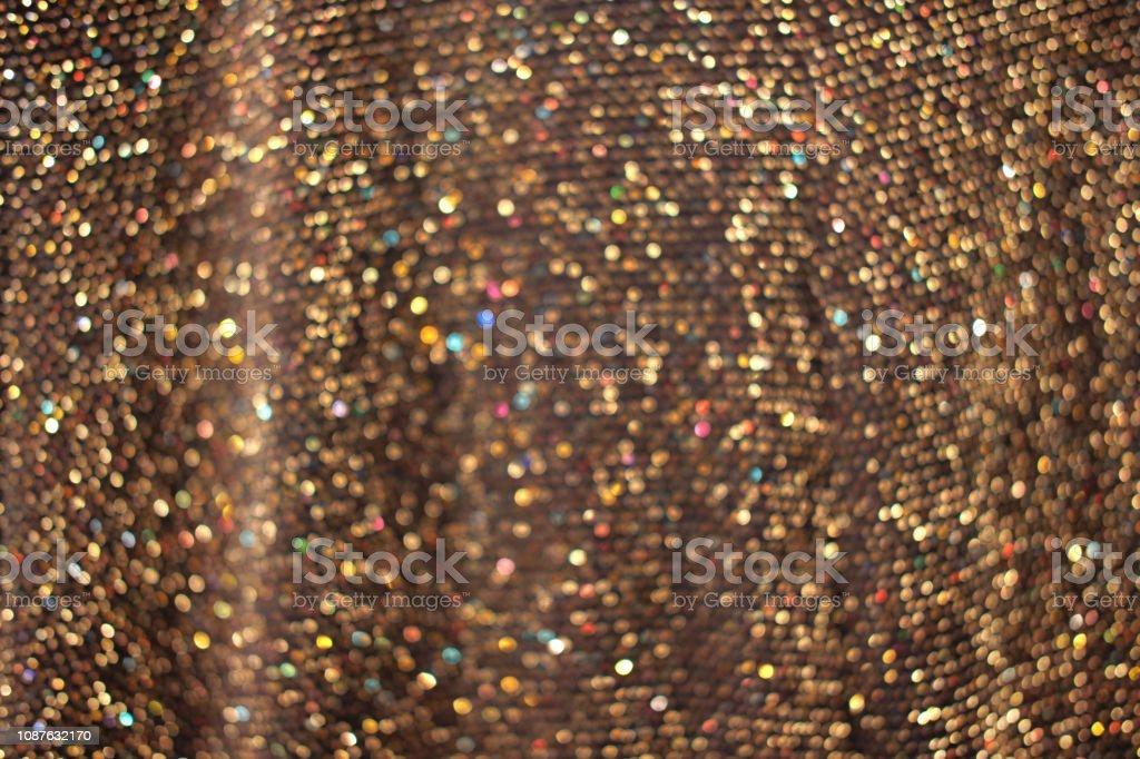 Glamour golden sparkling background. Blurred glitter texture. Festive...