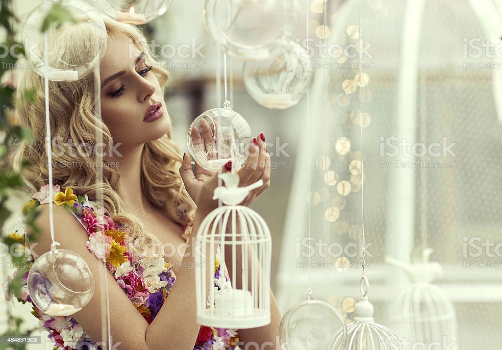 Glamour portrait of blond woman with baubles stock photo