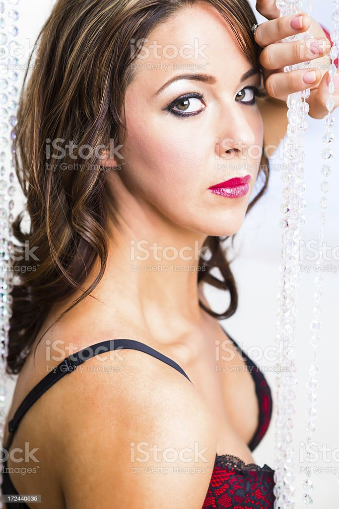 Glamour portrait with crystal curtain royalty-free stock photo