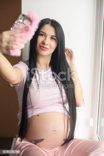 istock Glamour pregnant woman make selfie 928526296