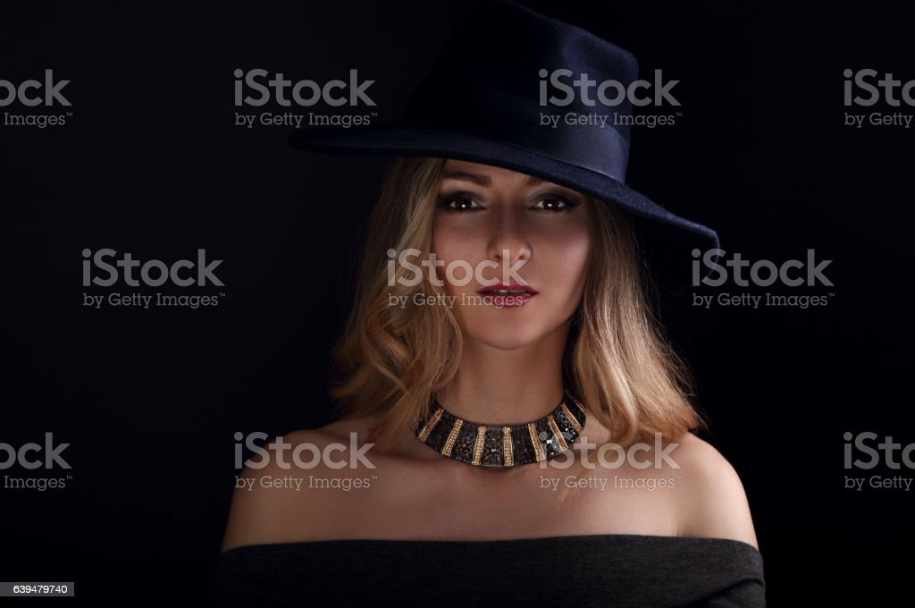 Glamour sexy makeup woman posing in fashion hat stock photo