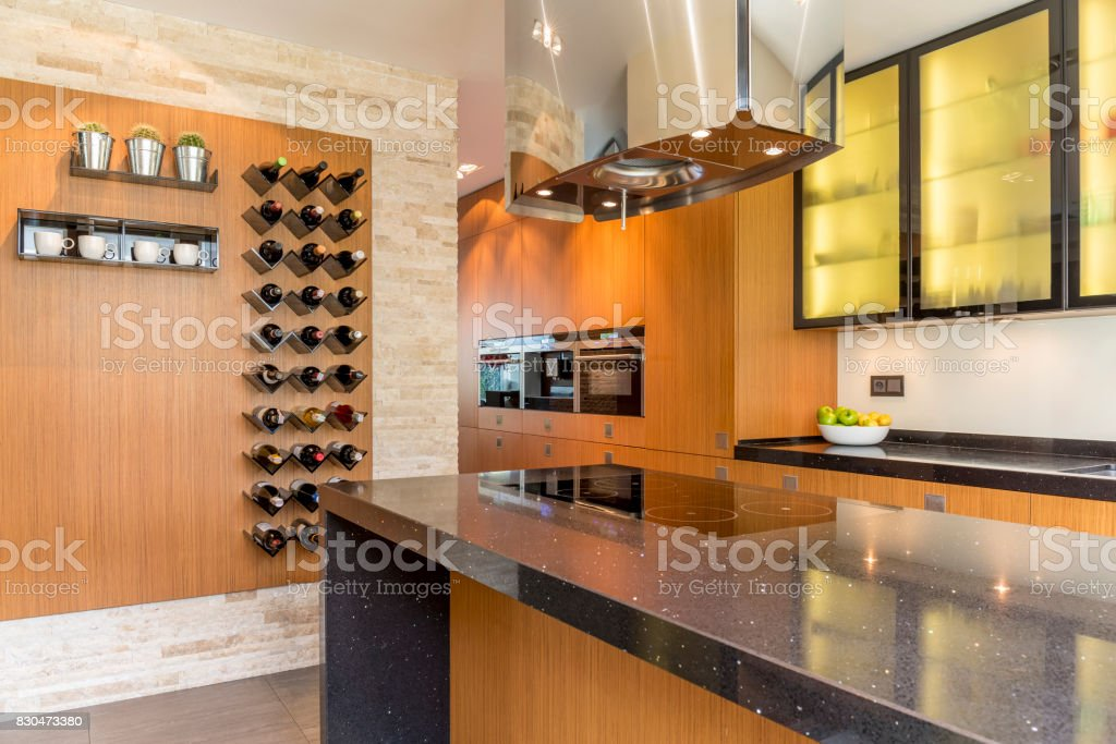 Glamourous kitchen with wooden cabinets stock photo
