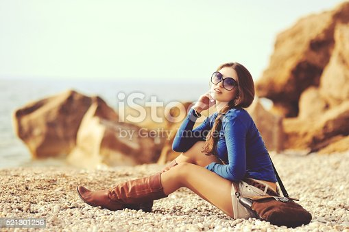 istock glamourous portrait of the young beautiful woman in leather boots 521301256