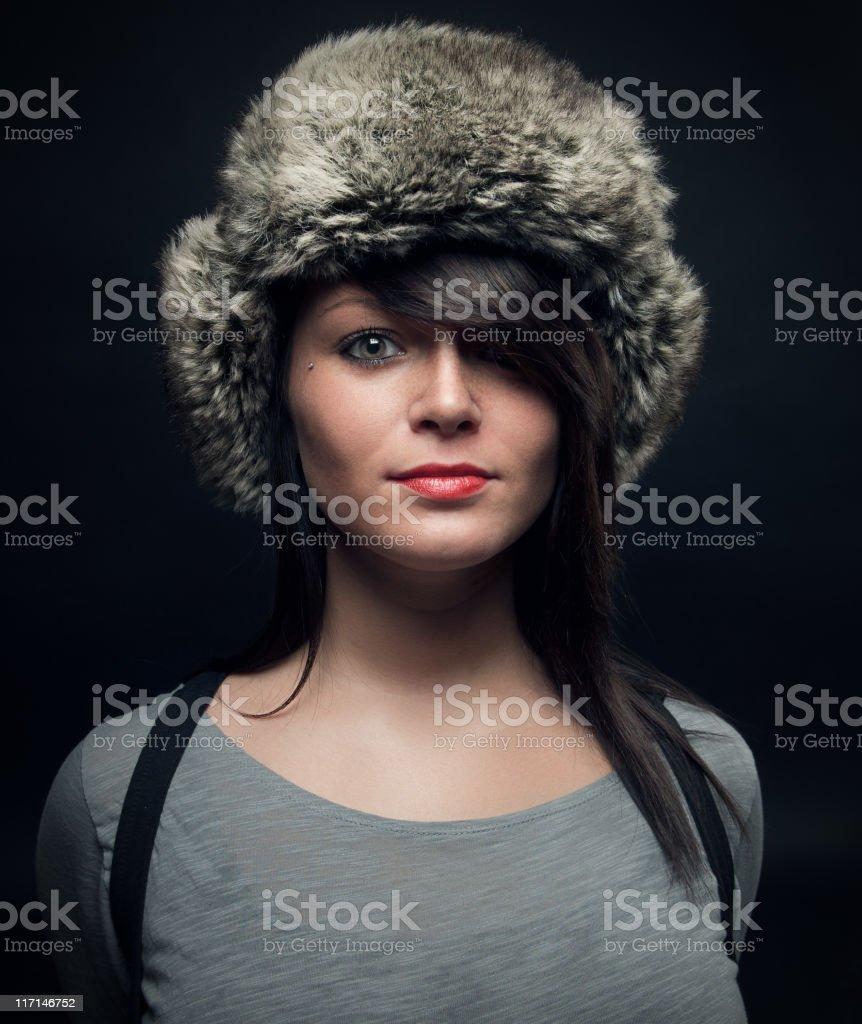 Glamourous woman wearing fur hat royalty-free stock photo