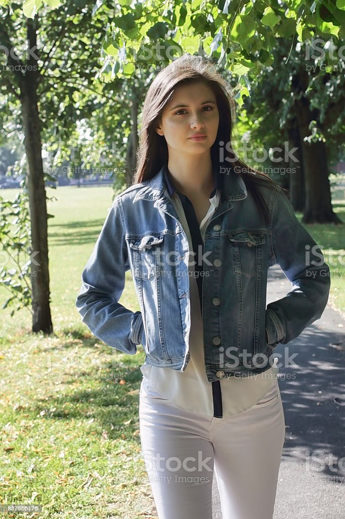 Glamourous young Bulgarian outdoor girl walking in the countryside stock photo