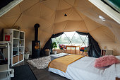 Interior of the living space of a space-age style dome tent at a glamping site in Northumberland.