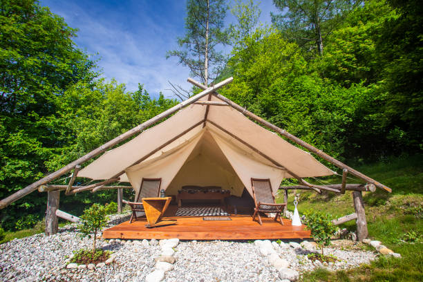 Glamping tent exterior in Adrenaline Check eco camp in Slovenia. stock photo