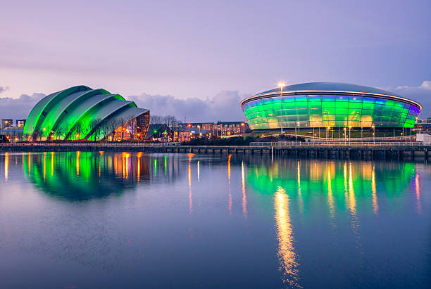 SECC, Glasgow Glasgow, UK - February 6, 2014: The Scottish Exhibition and Conference Centre Clyde Auditorium (commonly known as the Armadillo) and the Scottish Hydro Arena lit up green at night and reflected in the River Clyde as it flows through Glasgow. theasis stock pictures, royalty-free photos & images